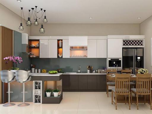 Khu bếp nấu kết hợp phòng ăn thoáng gọn, ngăn nắp. Bàn bếp kéo dài thành bar mini kiêm bàn ăn sáng tiện dụng cho 2 người cùng lúc.