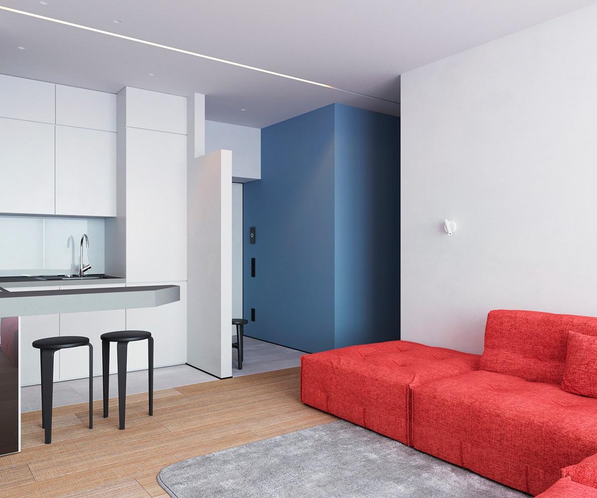 """Sắc đỏ cam và xanh dương tạo cảm giác tươi mới, sinh động hơn cho không gian nội thất phong cách tối giản """"less is more""""."""