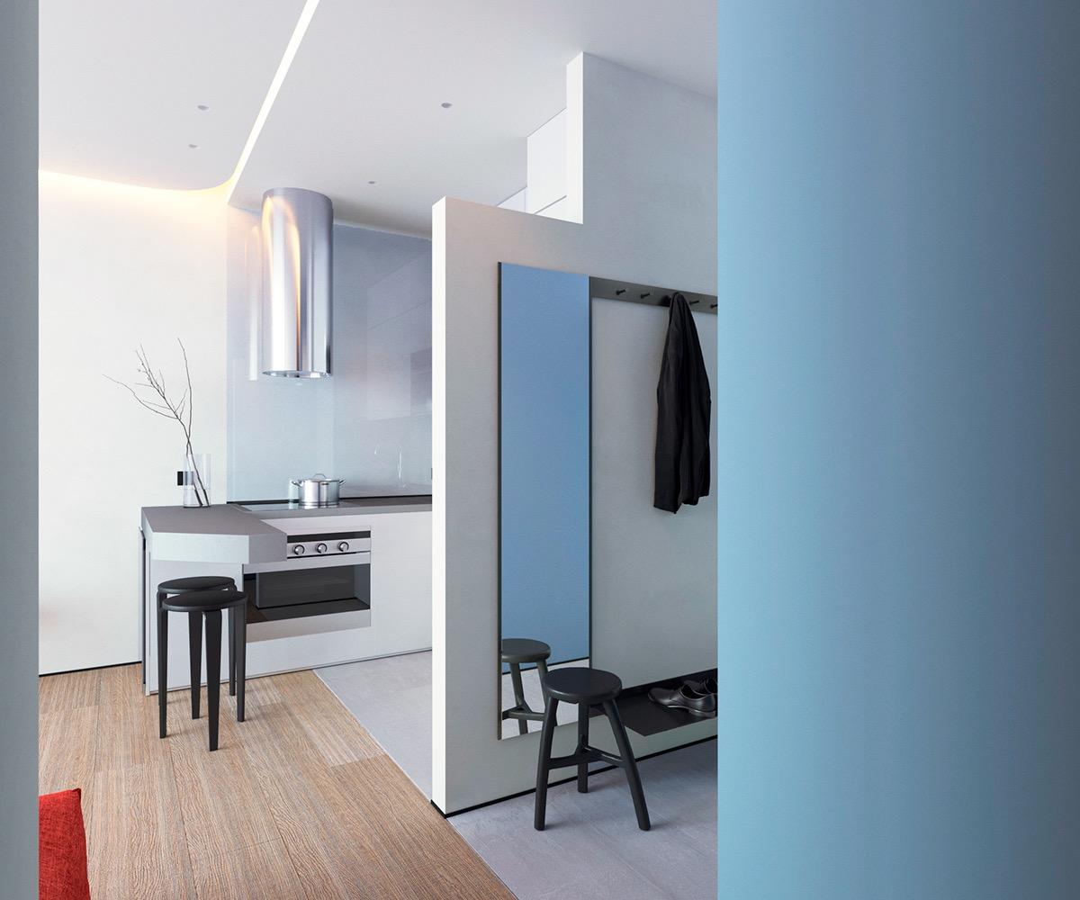 Thiết kế bàn đảo bếp ăn nhập vào khu vực tiếp khách, trong khi lối vào được tận dụng để bố trí tủ lưu trữ, kệ giày dép và gương lớn gắn tường.
