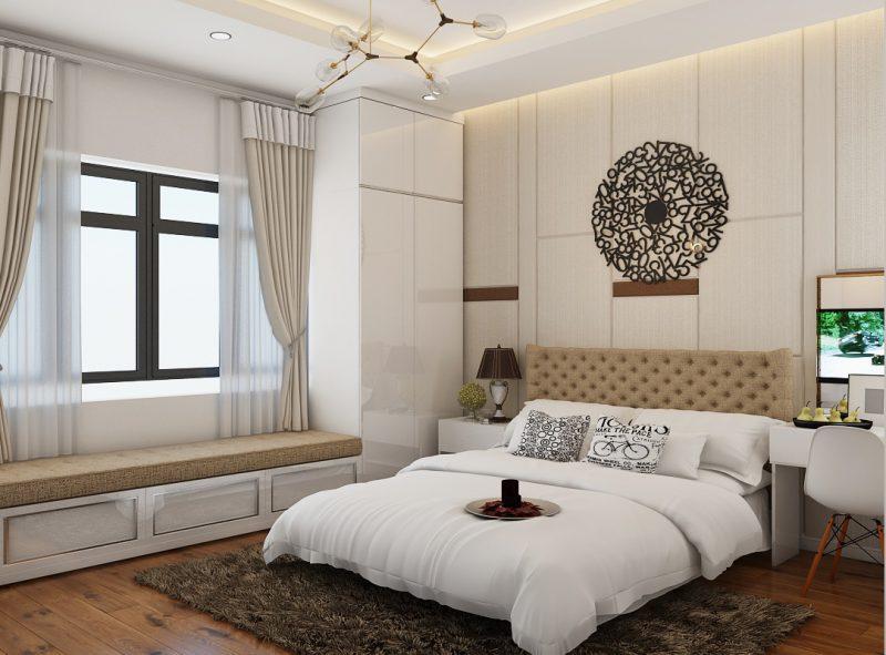 Phòng ngủ master sử dụng nội thất hiện đại, cao cấp với điểm nhấn trang trí tinh tế trên tường đầu giường. Ghế ngồi bên cửa sổ là góc thư giãn, đọc sách lý tưởng.