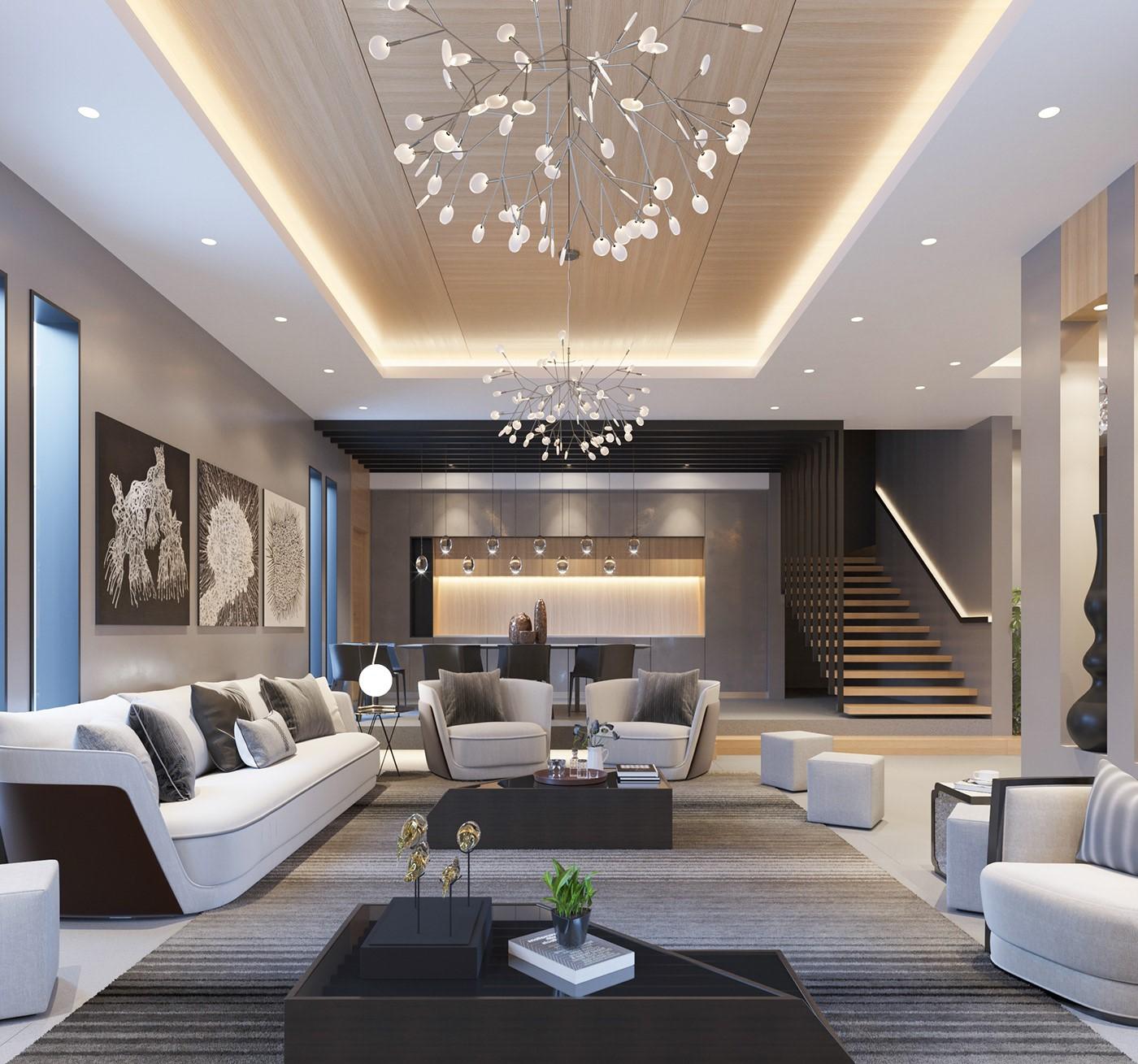 Phòng khách biệt thự 2 tầng sang trọng với bộ sofa trắng kết hợp gối tựa màu xám trung tính. Đèn chùm tạo điểm nhấn tinh tế cho toàn bộ không gian.